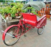 Rickshaw. A lonesome rickshaw parked in the middle of a garden centre Royalty Free Stock Photo