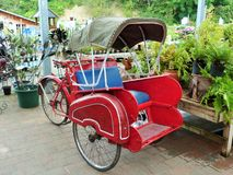 Rickshaw. A lonesome rickshaw parked in the middle of a garden centre Stock Photos