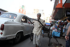 Rickshaw man pulls the customer, Kolkata Stock Photo