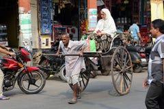Rickshaw man pulls the customer, Kolkata Royalty Free Stock Photography