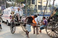 Rickshaw man pulls the customer, Kolkata Stock Photography