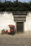 Rickshaw and old Chinese Doorway royalty free stock images