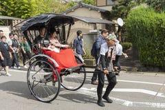 Pulled rickshaw transportation Arashiyama Japan. Rickshaw, originally denoted a two or three-wheeled passenger cart, now known as a pulled rickshaw. Transporting Royalty Free Stock Photography