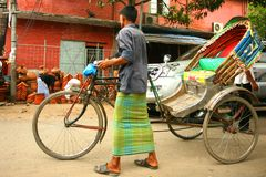 Rickshaw puller. Life in Dhaka city,Bangladesh royalty free stock photo