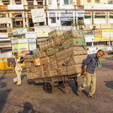 Rickshaw rider transports cargo Stock Photos