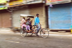 Rickshaw rider transports passenger Stock Photography