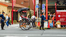 Rickshaw service man a local vehicle and service at Sensoji temple the famous temple in Tokyo. Stock Photos