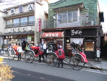 Rickshaw on the streets of Kamakura Japan. The rickshaw as we know it was invented in Japan in the late 19th century during the modernizing Meiji Period. People Royalty Free Stock Image