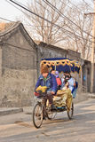 Rickshaw tour through ancient hutong area, Beijing, China Stock Photography