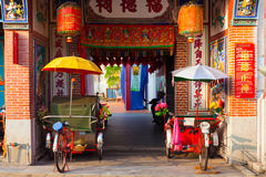 Rickshaw tricycles near the temple, Penang, Malaysia. Rickshaw tricycles near the entrance to Hock Teik Cheng Sin Temple, Armenian Street, Penang, Malaysia Royalty Free Stock Photos