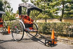 The Rickshaw, a two wheeled human powered taxi in Kyoto, Japan, Stock Photo