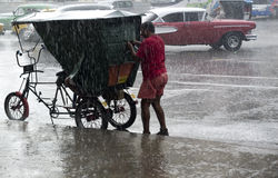 Rickshaw under a rainfall in Havana. Stock Photo