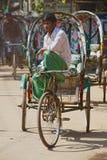 Rickshaw waits for passengers in Bandarban, Bangladeshickshaw waits for passengers at the street in Bandarban, Bangladesh. Royalty Free Stock Image