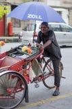 Rickshawchaufför Royaltyfri Foto