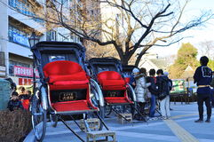 Rickshaws in asakusa, tokyo , japan. The picture shows rickshaw being parked waiting for willing passenger. The rickshaw is normally rented by tourist and pulled Royalty Free Stock Images