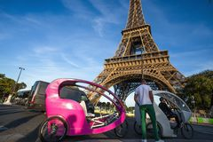 Rickshaws for tourists near Eiffel Tower in Paris, France. stock photography