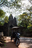 Rickshaws at Victory Gate of Angkor Thom. Waiting for tourist take a picture Royalty Free Stock Photo