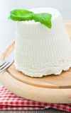 Ricotta cheese with basil leaves. Royalty Free Stock Photos