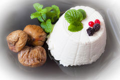 Ricotta cheese with berries, dried figs and some leaves of green fresh mint. Ricotta cheese with berries and dried figs and some leaves of green fresh mint Stock Images