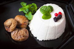 Ricotta cheese with berries, dried figs and some leaves of green fresh mint. Ricotta cheese with berries and dried figs and some leaves of green fresh mint Stock Photography