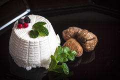 Ricotta cheese with berries, dried figs and some leaves of green fresh mint. Ricotta cheese with berries and dried figs and some leaves of green fresh mint Stock Image