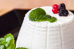 Ricotta cheese with berries and green fresh mint Stock Images