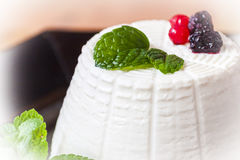 Ricotta cheese with berries and some leaves of green fresh mint. Ricotta cheese with berries figs and some leaves of green fresh mint Stock Images