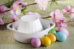 Ricotta cheese and colorful easter chocolate eggs Royalty Free Stock Photos