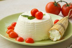 Ricotta cheese on a green plate Stock Image