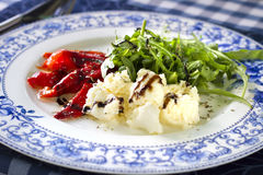 Ricotta cheese with grilled red pepper and arugula salad Stock Images