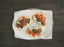 Ricotta and cherry-tomato sandwiches with fresh thyme Royalty Free Stock Photography