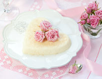 Ricotta dessert. Heart-shaped ricotta dessert with candied roses for Valentine's Day stock photography