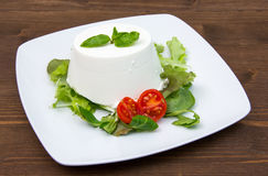 Ricotta on dish on wood Stock Photos