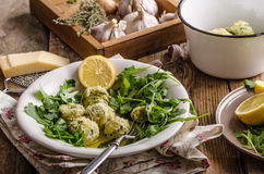 Ricotta dumplings with spinach Stock Photos