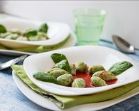 Ricotta and spinach gnocchi. high key stock photo
