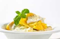 Ricotta and spinach tortelloni with cream sauce and Parmesan Royalty Free Stock Images