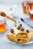 Ricotta stuffed crepes with honey, blackberries and mint royalty free stock image