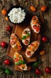 Ricotta tomato Basil bruschetta. On a dark background. toning. selective focus Royalty Free Stock Image