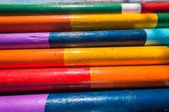 Rid- Wood Poles färger Arkivbilder