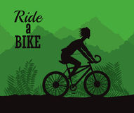 Rida en cykeldesign Arkivbild