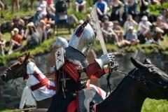 Riddare som slåss på hästrygg Arkivbild