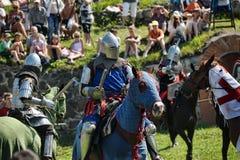 Riddare som slåss på hästrygg Arkivfoto