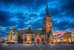 Riddarholmen Church at dusk in Stockholm HDR image. HDR image of Riddarholmen Church at dusk located in Old Town Gamla Stan of Stockholm, Sweden Stock Photos