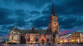 Riddarholmen church at dusk in Stockholm. Riddarholmen church at dusk located in Old Town Gamla Stan of Stockholm, Sweden static image with animated sky stock video footage