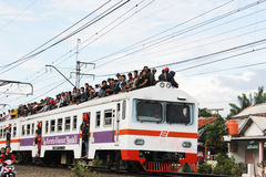 Ridding on The Roof of Carriage. Jakarta, Indonesia, 9 February 2012 - Passengers were ridding on the roof of the train carriage Stock Image