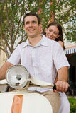 Ride. Couple sitting on motorcycle, smiling Stock Photo