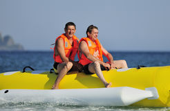 Ride a banana boat Stock Photo
