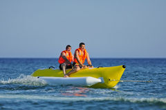 Ride a banana boat Stock Image