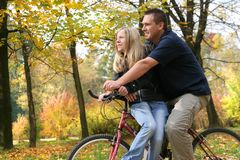 Ride A Bicycle. Two people riding a bike Stock Image