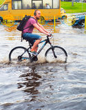 Ride bicycle in the rain Royalty Free Stock Image